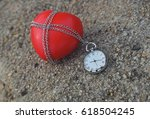 old pocket watch and red heart... | Shutterstock . vector #618504245