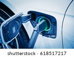 charging an electric car battery | Shutterstock . vector #618517217