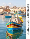 Small photo of Mediterranean traditional colorful boats luzzu. Fisherman village in the south east of Malta. Early winter morning in Marsaxlokk, Malta.