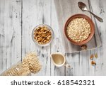 oat flakes in brown clay bowl... | Shutterstock . vector #618542321