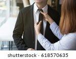 woman's hands adjusting black... | Shutterstock . vector #618570635