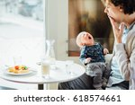 happy father and his newborn... | Shutterstock . vector #618574661