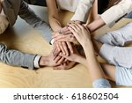business team  stacked their... | Shutterstock . vector #618602504