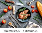 meat for steak with rosemary... | Shutterstock . vector #618603461