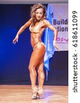 Small photo of MAASTRICHT, THE NETHERLANDS - OCTOBER 25, 2015: Female physique model Esther Blom shows her best side pose at championship on stage at the World Grandprix Bodybuilding and Fitness of the WBBF-WFF