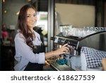 asian women barista smiling and ...   Shutterstock . vector #618627539