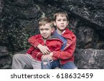 two sad boys hugging each other.... | Shutterstock . vector #618632459