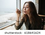 portrait of cute eating woman... | Shutterstock . vector #618641624