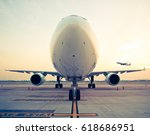 commercial airplane parking at... | Shutterstock . vector #618686951