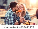 happy young couple hugging and... | Shutterstock . vector #618691997