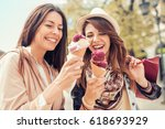 friends  two women with... | Shutterstock . vector #618693929