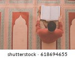 religious muslim man praying... | Shutterstock . vector #618694655