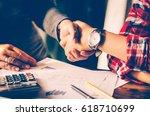 handshake between joint venture ...   Shutterstock . vector #618710699