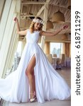 sexy young blonde bride in a... | Shutterstock . vector #618711299