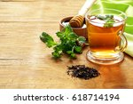 mint flavored tea in a glass cup | Shutterstock . vector #618714194