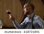 winemaker in wine cellar... | Shutterstock . vector #618721841