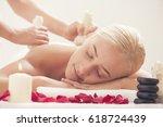 wellness. woman receiving body... | Shutterstock . vector #618724439