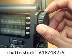hand tuning radio button | Shutterstock . vector #618748259