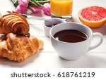 coffee and croissants. tasty... | Shutterstock . vector #618761219