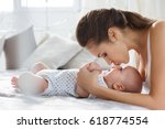 young mother playing with 5... | Shutterstock . vector #618774554
