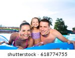 mother  father and daughter in... | Shutterstock . vector #618774755