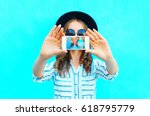 fashion woman is taking photo... | Shutterstock . vector #618795779