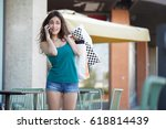 young woman holding shopping... | Shutterstock . vector #618814439