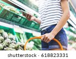 young woman shopping healthy...   Shutterstock . vector #618823331