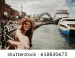 woman in sunglasses holding... | Shutterstock . vector #618830675