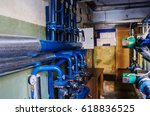 Small photo of Heat-regulating equipment in the basement of a heated building / Photo taken in Russia. Heating systems for apartment houses and heat meters. 03/31/2017