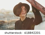 Small photo of Lovely stylish young teen girl with black hat. The port is abrasive against the background. Romantic affecting mood
