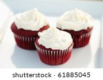 Three Red Velvet Cupcakes On A...