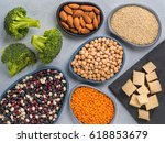Stock photo vegetarian healthy protein sources on gray concrete background quinoa chickpea almond red 618853679