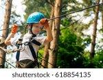 five year boy on rope way in... | Shutterstock . vector #618854135