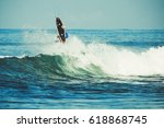 surfer on the wave. the surfer... | Shutterstock . vector #618868745