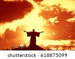 silhouette monk on the mountain ... | Shutterstock . vector #618875099