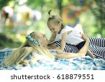 mom and daughter having fun and ... | Shutterstock . vector #618879551