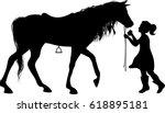 Little Girl Feeding Horse...