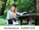 young woman reading a book in... | Shutterstock . vector #618907235