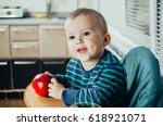 the child in the kitchen with a ... | Shutterstock . vector #618921071