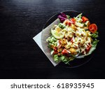 caesar salad with prawns on the ... | Shutterstock . vector #618935945