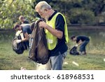 diverse group of people pick up ... | Shutterstock . vector #618968531