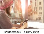 woman and smartphone in hand... | Shutterstock . vector #618971045