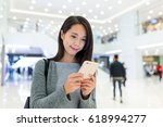 woman use of mobile phone in... | Shutterstock . vector #618994277