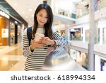 woman checking on cellphone | Shutterstock . vector #618994334
