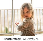 Small photo of Young caucasian baby girl with adoring look