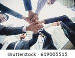 business team putting their... | Shutterstock . vector #619005515