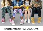 Diverse Group Of Kids Sitting...