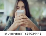 girl with a phone in a cafe in... | Shutterstock . vector #619034441