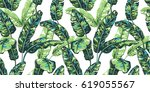 tropical palm leaves background.... | Shutterstock .eps vector #619055567